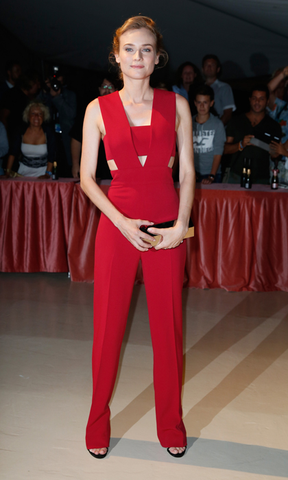 Keep wardrobe malfunctions at bay by trading a short party dress for an elegant jumpsuit in a festive hue. Here, Diane Kruger was the belle of the ball at the Venice Film Festival in a red Cushnie et Ochs number with cutout detailing.