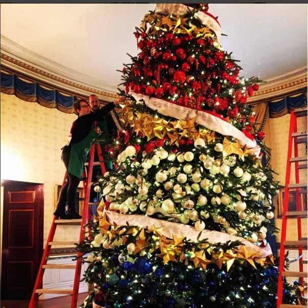 The US first family opted for a patriotic red, white and blue tree for holiday festivities in the White House this year. 