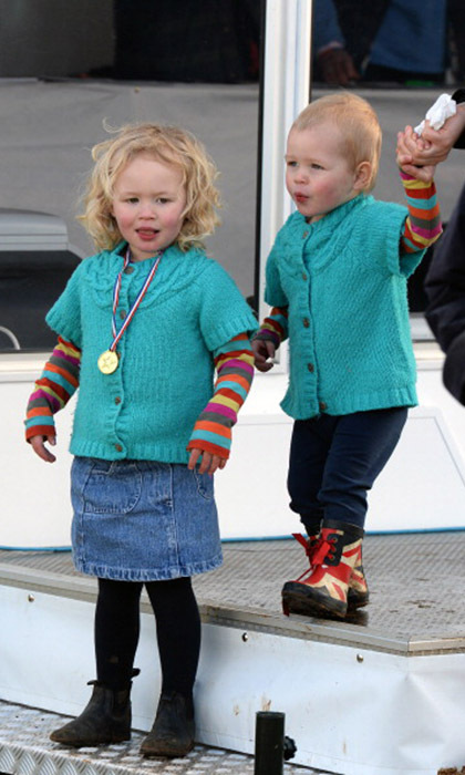 With her baby sister, Isla, by her side, Savannah took in all the action at the 2014 Gatcombe Horse Trials in England. 