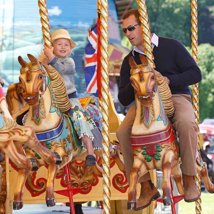 The four-year-old royal recruited dad Peter Phillips to ride the merry-go-round at the Royal Windsor Horse Show in 2015. 