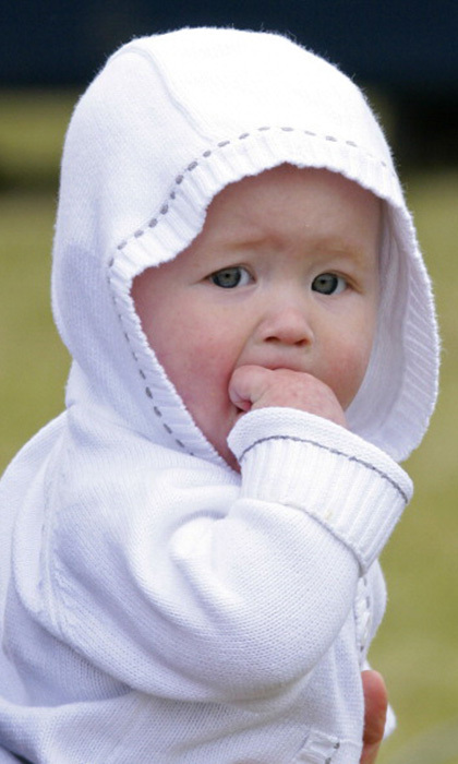 Wrapped up in a knitted white cardigan, the 18-month-old stole the show with her cuteness at the 2011 Festival of British Eventing. 