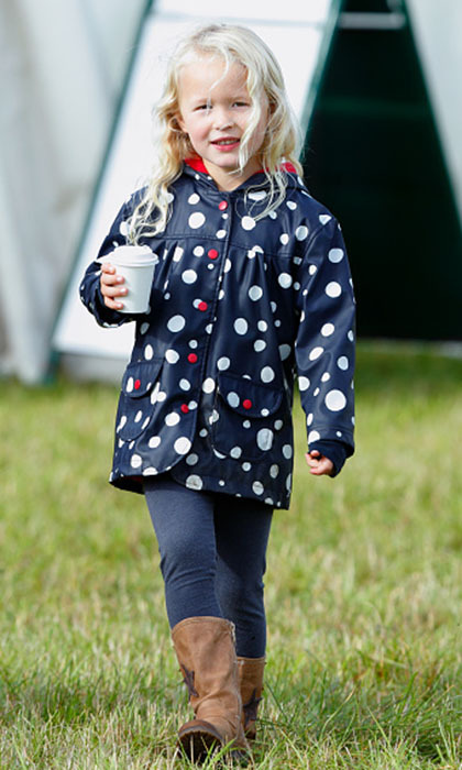 Looking quite the little lady, Savannah enjoyed a warm drink while taking a stroll during a day out in Stroud, England. 