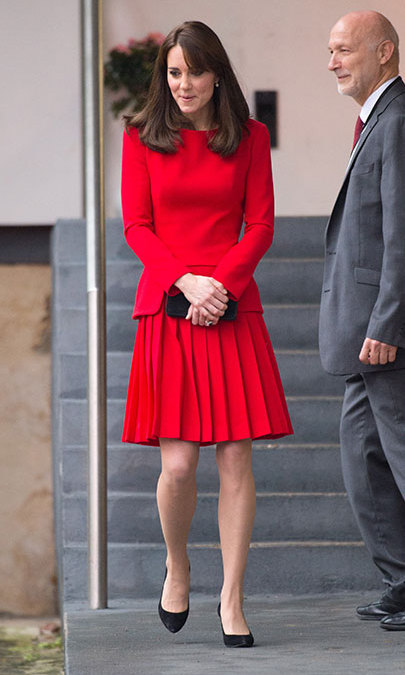 Kate showed off another piece from her closet, a festive red Alexander McQueen pleated dress, during a visit to the Anna Freud Centre on Dec. 15.