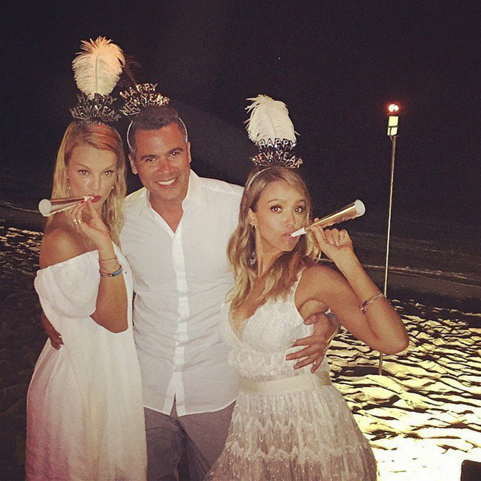 Jessica Alba, Cash Warren and Kelly Sawyer toasted the new year with a beach party. 