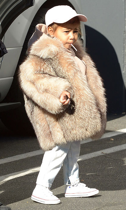 North West was spotted on an outing in L.A. with her aunt Kourtney. The tot was sporting a fur coat that she first wore at New York Fashion Week in February 2015. 