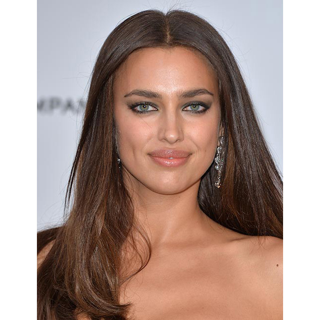 Irina topped beauty lists around the world when she stepped out for the amfAR gala in Cannes, wearing her hair down in a super sleek and chic style with a middle parting.
