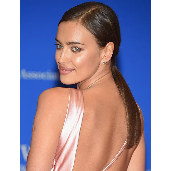 Taking the ponytail from day to night, Irina chose a low style, tied at the nape of neck, keeping all of her hair super sleek and smooth.