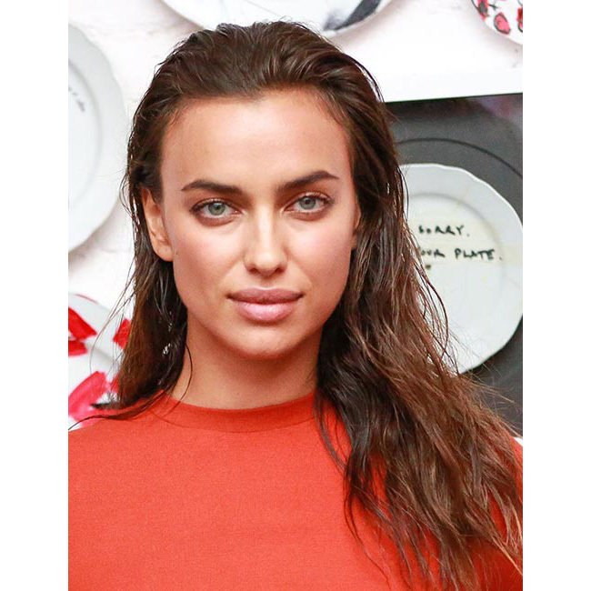 We were huge fans of Irina's tousled wet-look locks for a dinner hosted by Topshop and Ciara – add a touch of edge like the star by wearing the style slicked back.
