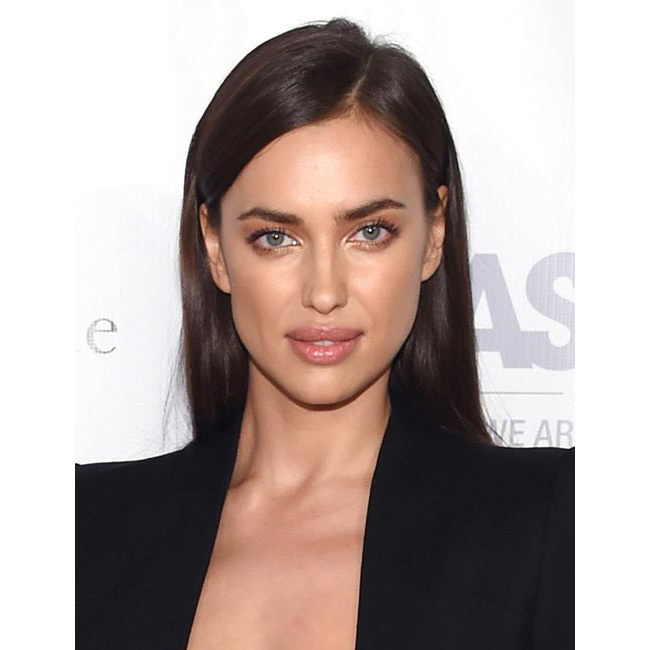 Looking as sultry as ever at a benefit in New York, Irina upped the beauty stakes with her poker straight hair worn pushed back.