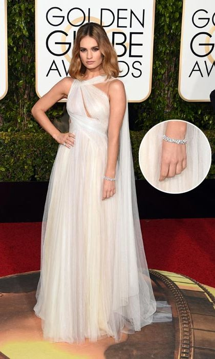 <strong>Lily James</strong> took her Marchesa gown to the next level with a Harry Winston diamond bracelet.<br>
