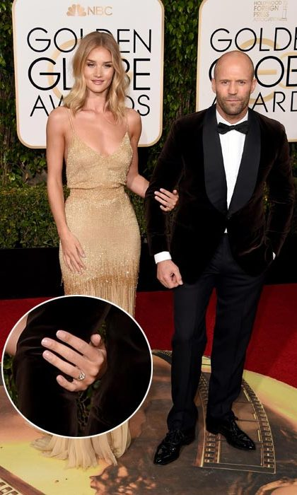 <strong>Rosie Huntington-Whiteley</strong> chose to forgo any accessories except one very special one - her new engagement ring! The actress proudly showed off the huge diamond, which appears to be oval-cut and set on a diamond band.<br>