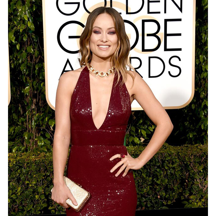 <strong>Olivia Wilde</strong> upgrades her already-stunning Michael Kors Collection gown with the addition of a jewelled choker, cocktail ring and gold clutch, all Bulgari.<br>