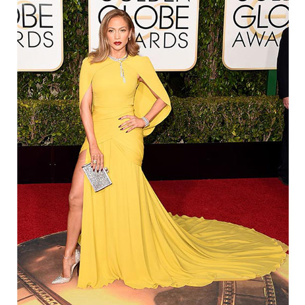 <strong>Jennifer Lopez</strong> lit up the red carpet in her mustard-yellow Giambattista Valli confection. Not one to do things by halves, she further upped her look with 200 carats of Harry Winston diamonds and sparkly Jimmy Choo heels.<br>