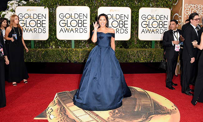 In white or ivory, Gina Rodriguez's Zac Posen gown would be perfect for the princess bride.