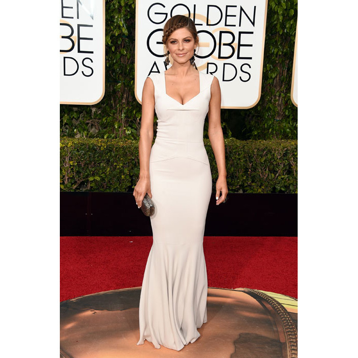 TV host Maria Menounos showed off her perfect figure in a white fishtail gown.