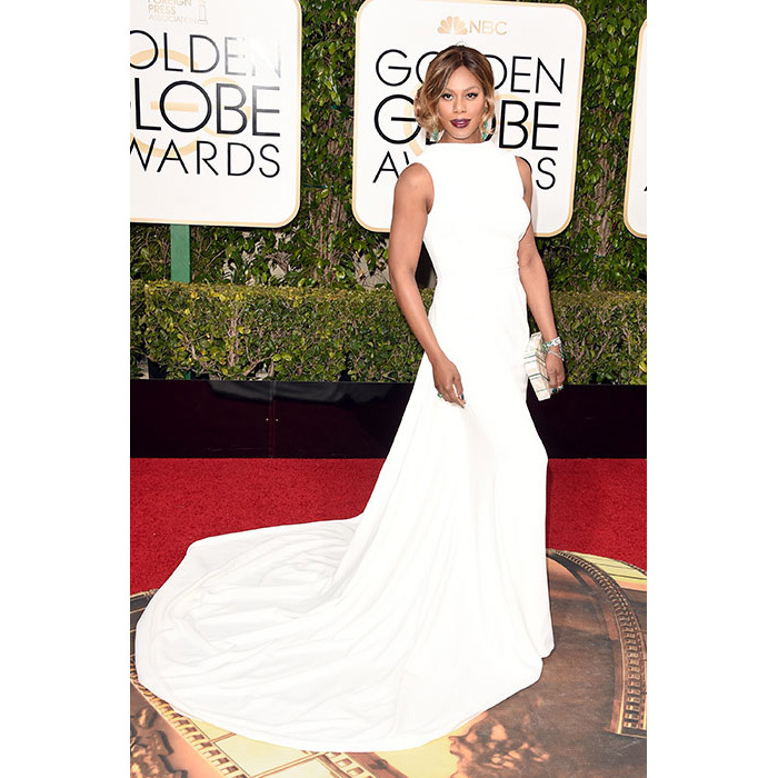 With its high neckline and sweeping train, Laverne Cox's gown would suit the demure bride.