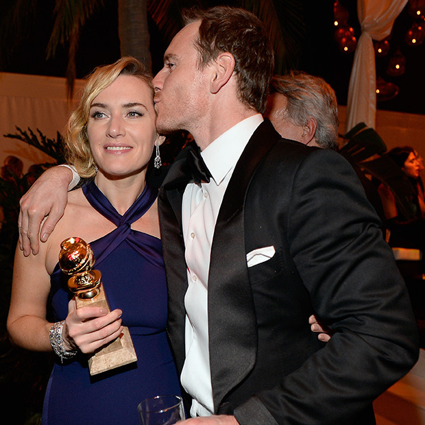 Michael Fassbender smooched his <i>Steve Jobs</i> co-star and winner of the Best Supporting Actress prize Kate Winslet at the NBC party. 