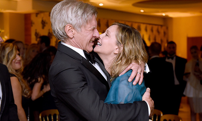Looking more in love than ever, Harrison Ford couldn't keep his hands off his wife Calista Flockhart. 