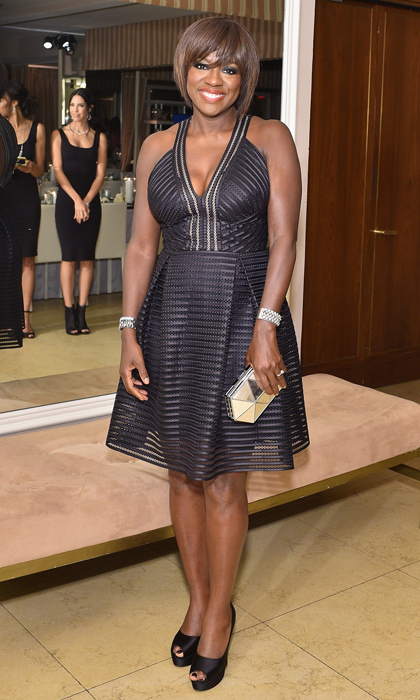 How to get away with looking fabulous? Just ask Viola Davis! The small screen siren was the picture of fun and flirty in a playful cocktail dress by Carmen Marc Valvo. Armed with her award-winning smile, this beauty will always come out on top in the court of fashionable opinion. 