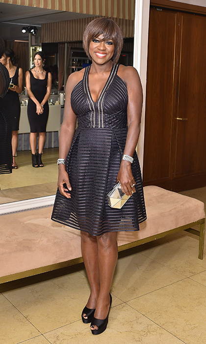 <i>How To Get Away With Murder</i> star Viola Davis stunned in a black cocktail dress by Carmen Marc Valvo,  Stuart Weitzman peep-toe pumps and a metallic Rauwolf clutch at the ELLE Women in TV dinner in West Hollywood.