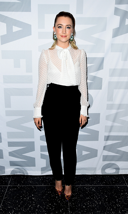 Oscar nominee Saoirse Ronan is sleek and sophisticated in sheer white blouse and high-waisted black pants by Laura Basci with pointy Christian Louboutin heels for the MoMA Film's The Contenders screening of <i>Brooklyn</i>.