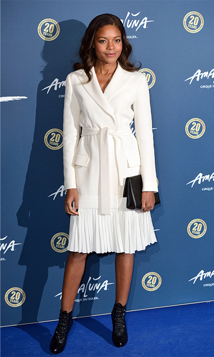 <i>Spectre</i> star Naomie Harris displayed ladylike elegance in a creamy white Dior belted jacket and pleated skirt at the Cirque Du Soleil Amaluna premiere in London. 