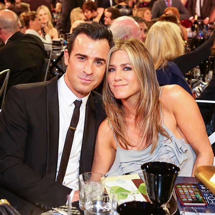 Loved-up couple Justin Theroux and Jennifer Aniston cozied up at the 21st Annual Critics' Choice Awards in Santa Monica. 