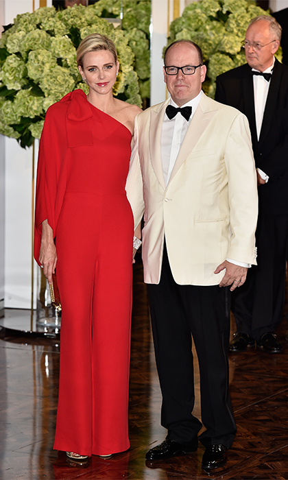 The lady in red stole the show at the Monaco Red Cross Ball in a one-shoulder jump suit that showed off her statuesque, swimmer's physique. She completed the look with gold, strappy heels.