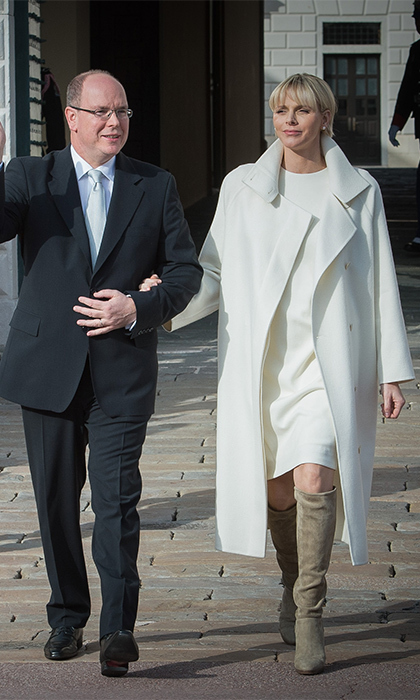 To introduce her little cherubs to the Monegasque people in January 2015, the Zimbabwe native topped her custom-made Albert Kriemler sheath dress with an Akris cashmere coat. She completed her winter white look with tawny suede boots. 
