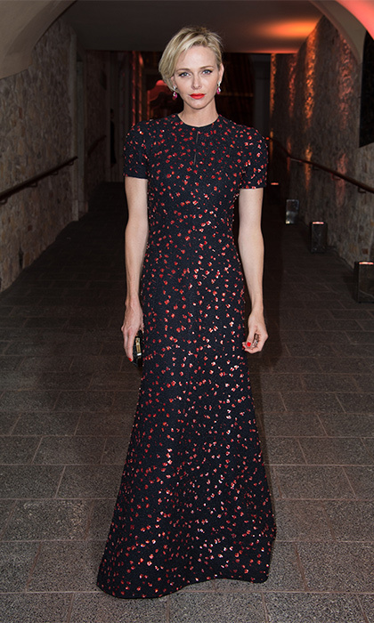Channelling the elegance of her husband's late mother, Princess Grace, Charlene floated into the 2015 Princess Grace Awards gala at Monaco's palace in a speckled, short-sleeved gown from Dior's fall 2015 collection. 