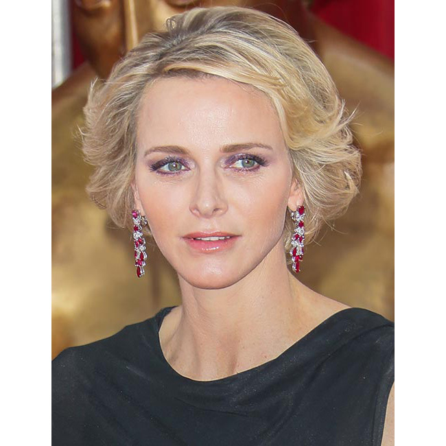 The stylish royal pulled out all the stops for the Monte Carlo TV Festival Opening Ceremony. Styling her glossy locks into volume-packed waves, she added a pop of colour to contrast her elegant black gown by opting for purple shimmering eyeshadow and glossy pink lip gloss.