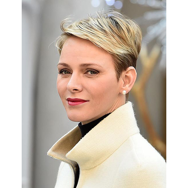 The mother of two upped the beauty stakes with her pixie cut swept into a sleek side parting, paired with berry-red lipstick and soft smoky eye makeup look for daytime glamour.