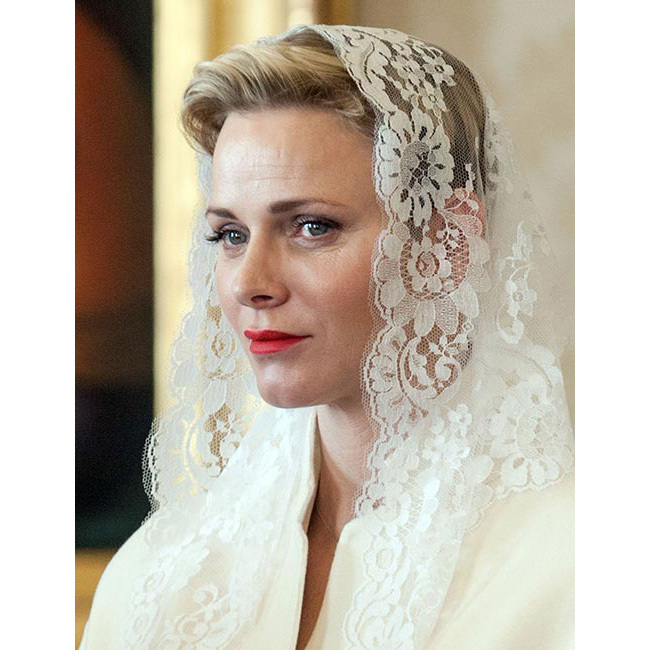 Princess Charlene was the epitome of elegance as she joined husband Prince Albert for an audience with the Pope, opting for a touch of mascara and red matte lips for a simple yet chic look.
