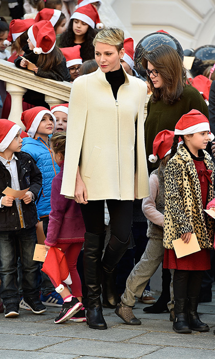 Charlene was a caped crusader while handing out presents at the Palace's annual Christmas party in December 2015. 