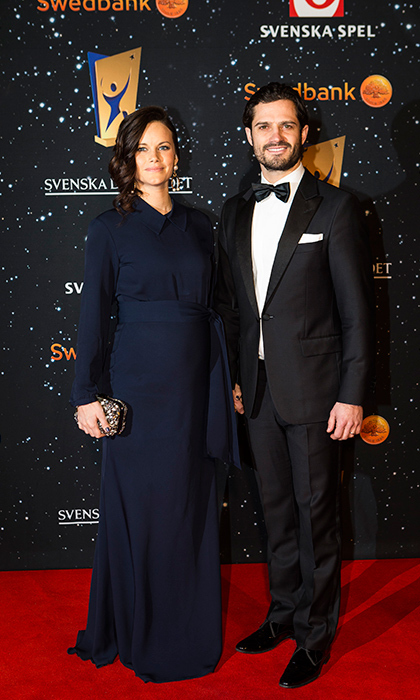 Mom-to-be Sofia looked simply stunning in a long-sleeved navy blue gown with a belted waist at the Swedish Sports Gala on Jan. 25. The royal accessorized the elegant ensemble with a sparkly clutch and a very handsome man - her husband Prince Carl Philip.  