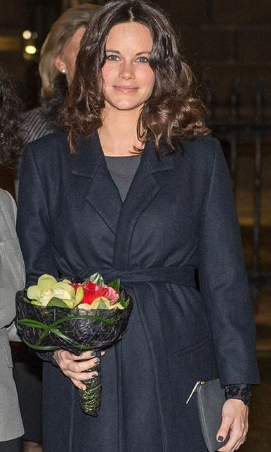 With her brown locks in curls and a fresh face of barely there makeup, the mother-to-be stunned on an outing to the Great Synagogue to mark Holocaust Memorial Day. Sofia wrapped up in a chic navy belted coat and carried a grey leather clutch with coordinated nail polish.