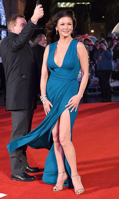 Catherine Zeta Jones blew away the fashion competition in a sexy cerulean-blue gown at the premiere of <i>Dad's Army</i> in London. 