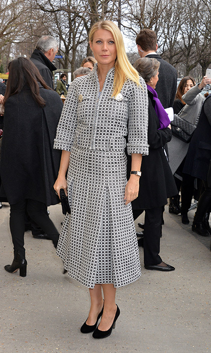 Ladylike Gwyneth Paltrow wore a skirt suit straight off Chanel's spring 2016 runway, pairing a fitted, high-collared jacket with oversized gem buttons with a full, '50s-style skirt. 