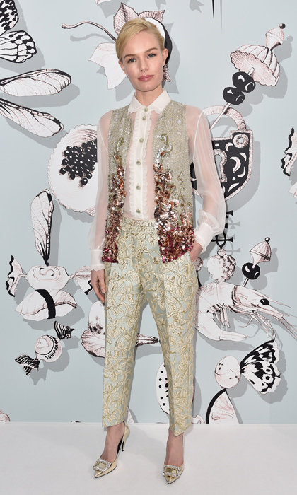 Embellishments were the name of the game for Kate Bosworth at the Schiaparelli show at Paris Haute Couture Fashion Week. The blond beauty paired the brand's patterned pastel pencil pants with a heavily sequinned vest and sheer white blouse featuring the brand's namesake on the buttons. Kate finished it off with jewel-embellished, metallic gold Roger Vivier pumps.
