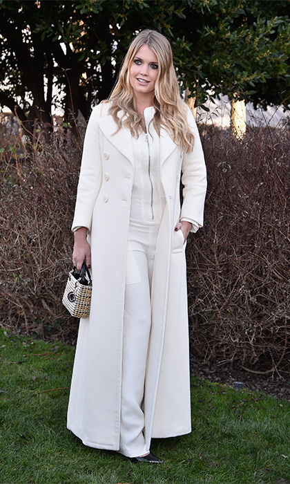 Princess Diana's niece Lady Kitty Spencer gave a floor-length, off-white Dior coat a youthful twist by pairing it with a coordinated jumpsuit. Naturally she chose Dior accessories too, shades and a mini gold handbag, to take in the brand's couture collection.