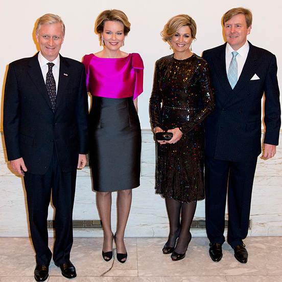Queen Mathilde and Queen Maxima, pictured with their husbands