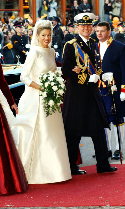 The 29-year-old economist had arrived punctually on the arm of her soon-to-be husband, Crown Prince Willem-Alexander of the Netherlands, at Amsterdam's former stock exchange Beurs van Beurlage for the civil ceremony.