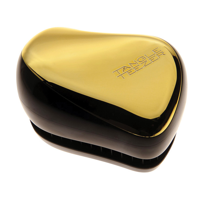 Detangle hair after a shower without pulling or breakage with this compact brush.