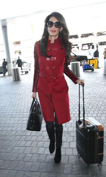 Rocking a red Versace coat when arriving at LAX airport.