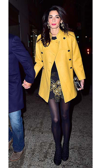 Looking elegant in a mustard yellow coat and printed dress for a night out with George.