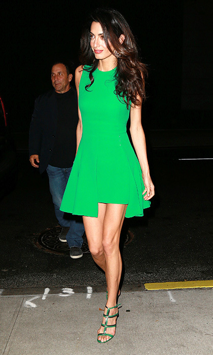 Amal showed off her high fashion style credentials in this bold green dress by Versace.