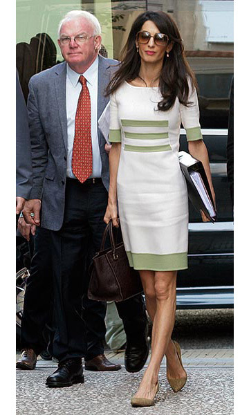 Arriving for a court case in Athens in a chic dress.