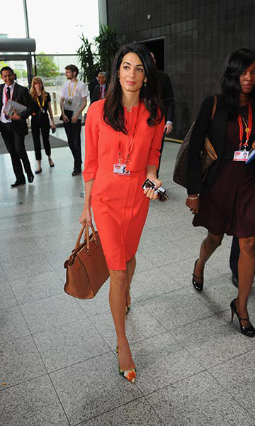 Chic in an orange dress as she arrived in London for the Global Summit to end Sexual Violence in Conflict.