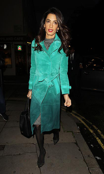 Amal turned heads while out and about in a dazzling green Burberry $8,476 trench coat.