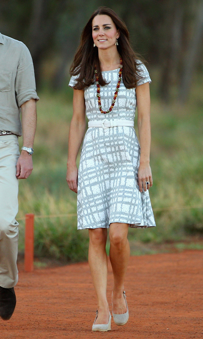 Kate is a pro at turning a simple dress, like this grey-and-white printed Hobbs frock, into a more sophisticated look by adding a solid-coloured belt. 